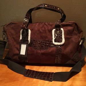 Brown travel bag with Sherpa accents
